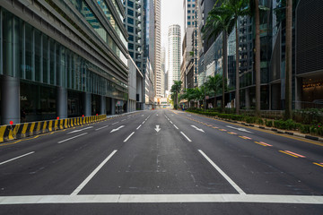 Quiet Singapore street with less tourists and cars during the pandemic of Coronavirus disease (COVID-19). Fotobehang