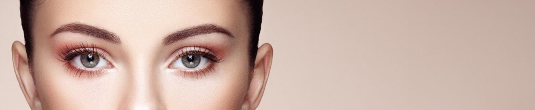 Female Eye with Extreme Long False Eyelashes. Eyelash Extensions. Makeup, Cosmetics, Beauty. Close up, Macro