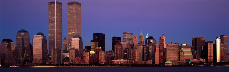 Wall Mural - Panoramic view of lower Manhattan and New York City skyline, NY with World Trade Towers at sunset