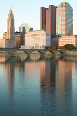 Wall Mural - Scioto River and Columbus Ohio skyline in autumn with sunset reflection in water