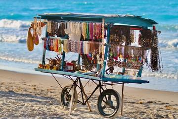 Wall Murals Caribbean Jewelry cart on Cuban beach built on a bike