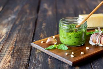 Italian pesto sauce on a wooden background. National kitchen. Healthy eating. Vegetarian food. Recipe. Papier Peint
