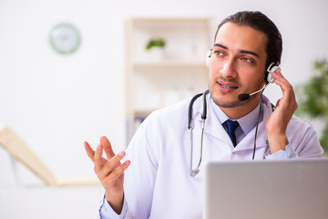 Young doctor listening to patient during telemedicine session