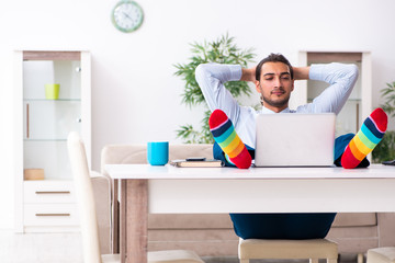Young male businessman working at home