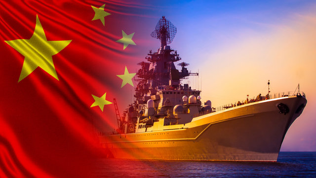 Warship close-up on the background of the Chinese flag. Protection of the water borders of the Republic of China. China's Navy. The Chinese fleet. Equipment of the Chinese army.