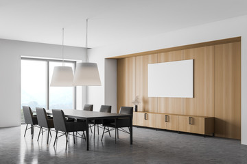 White and wooden dining room corner with poster