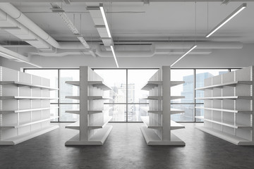 Empty shelves in white supermarket, side view