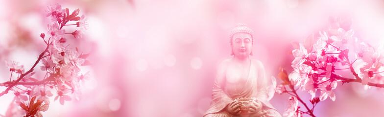 buddha unter blühenden kirschzweigen