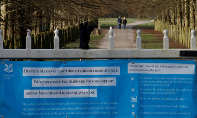 A sign informing people that the National Trust property at Dunham Massey is closed is seen amid the coronavirus outbreak in Altrincham, Britain