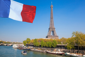 Fototapete - Paris with Eiffel Tower against french flag during spring time in France