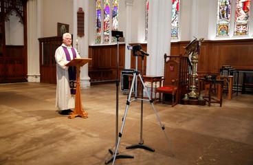 Revd Mark Dearnley poses for a picture after Church services were recorded for a live service streaming on YouTube at St Peter's Church as the spread of the coronavirus disease (COVID-19) continues