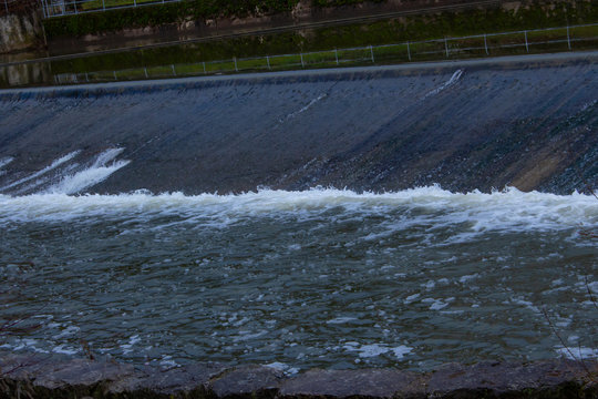 Small dam, also called a weir with water flowing over it