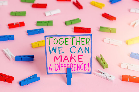 Word writing text Together We Can Make A Difference. Business photo showcasing be very important some way in like team or group Colored clothespin papers empty reminder pink floor background office