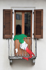 A sign depicting a map of Italy holding hands hangs on a balcony in Serina near Bergamo, one of Italy's cities worst-hit by coronavirus disease (COVID-19)