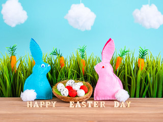 Easter background with eggs, rabbits and green grass