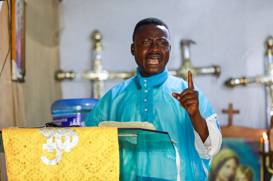Superior elder prophet Ayobami Atanda delivers a sermon during a church service amid concerns about the spread of coronavirus disease (COVID-19) at the Celestial Church of Christ, in Makoko community area in Lagos