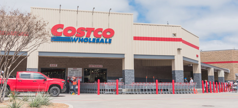 Entrance of Costco Wholesale store in Lewisville, Texas with row of sanitized shopping carts