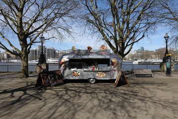 A hot dog carvan sits on the South Bank of the River Thames
