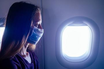 woman feeling bad in aeroplane fly afraid