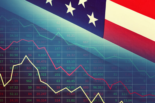 Economic and financial crisis concept. Stock market graphs and usd dollar against ameican flag on the dark background