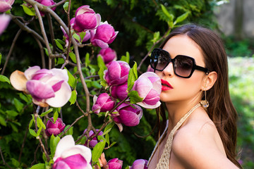 Close-up portrait of caucasian girl in sunglasses. Young woman enjoying life and having fun at spring park. Sunglasses for summer,