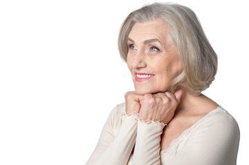 Close up portrait of happy senior woman posing on white background