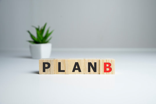 Wooden cube block word plan A to plan B