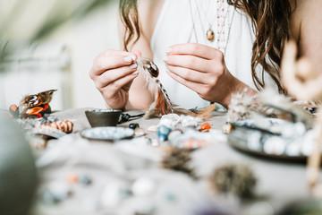 Woman hands making gemstone jewellery, home workshop. Women artisan created jewellery. Art, hobby, handcrafted concept