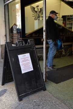 COVID 19, Take out, liquor store, masks out and about for Coronavirus Disease COVID-19 Pandemic Impacts New Yorkers