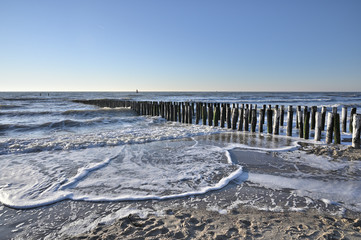 Canvas Print - Breakwaters on the beach in Vlissingen Holland
