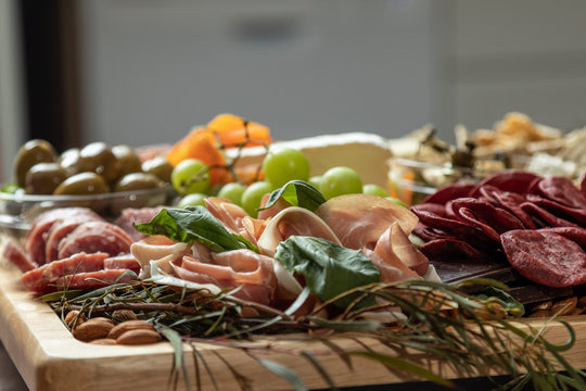 Closeup of Gourmet Charcuterie Board with Copy Space. Macro Selective Focus.