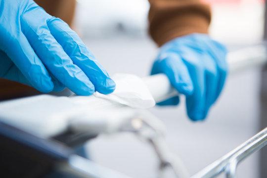 Disinfecting the handle of shopping basket. Coronavirus Epidemic Outbreak