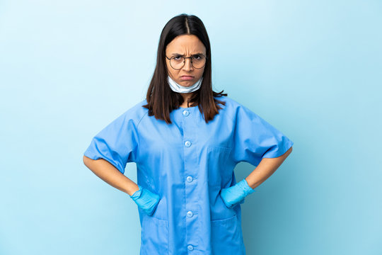 Surgeon woman over isolated blue background angry