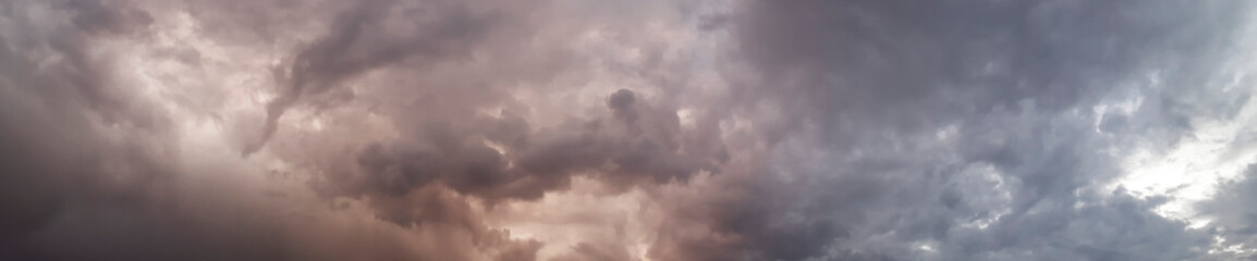 Sky with dark clouds and light rays