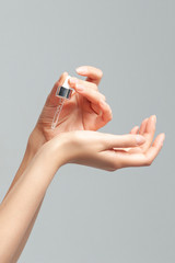 Hands of young woman with a pipette closeup