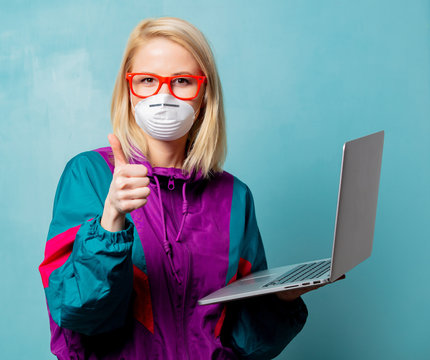 Style blonde woman in 90s clothes and face mask holds notebook