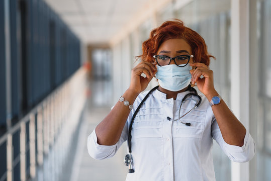 Young attractive african doctor with face mask
