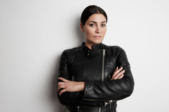 Portrait of attractive biker girl wearing leather jacket.