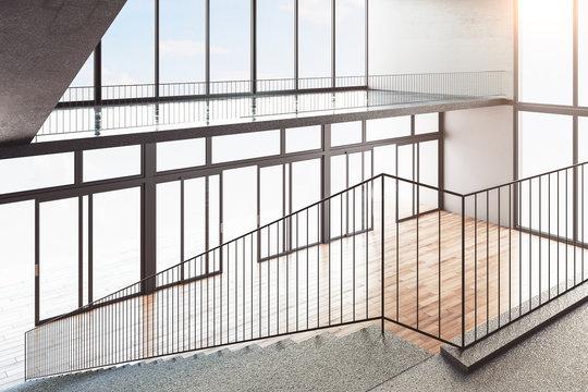 Staircase on concrete building interior.
