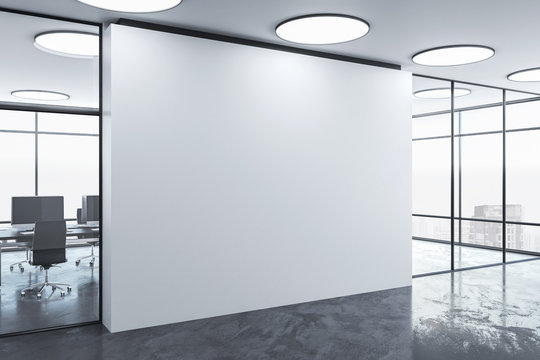 Blank wall in office interior.