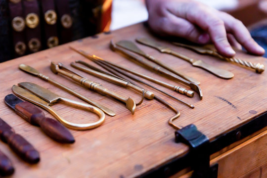 old surgical medical instruments help people, military medicine of the middle ages