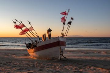 Fishing boats on the sea sandy beach