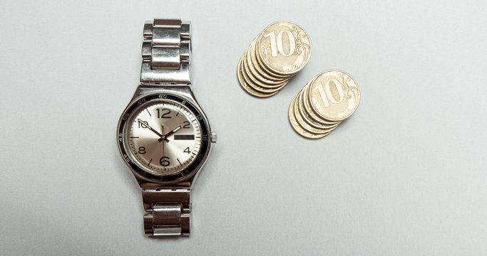 Watches combined with money coins to denote the concept o