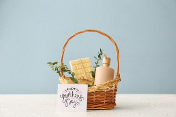 Basket with gifts for Mother's Day on table