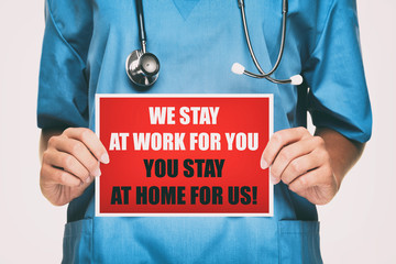 COVID-19 Coronavirus doctor holding sign for viral social media post showing: