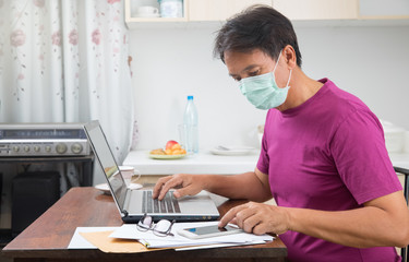 Male work at home to help protect infection of coronavirus (COVID-19) from outside