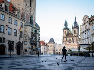 Autocollant pour porte Prague Prague, Czech republic - March 17, 2020: Man with the mask is walking in the historical centre in Prague after coronavirus pandemic. Prague street empty due to coronavirus. Almost deserted