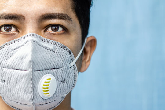 A man is wearing n95 mask for protect covid 19 and air pollution pm2.5