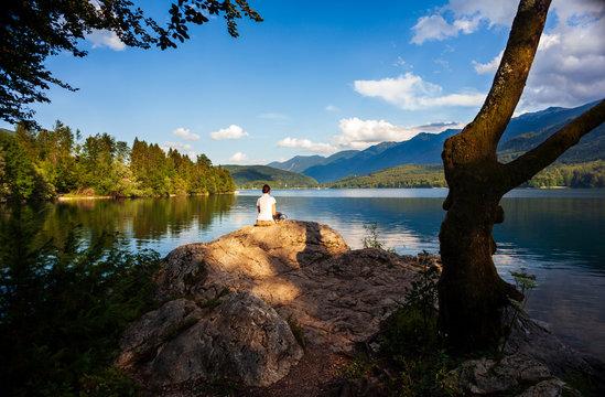 Girl looking the scenic Bohinj lake
