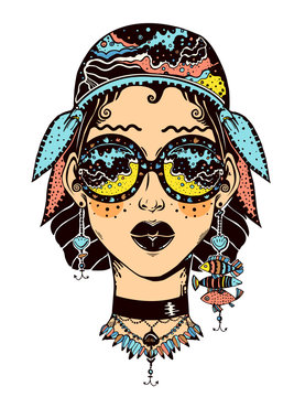 Young beautiful sailor girl looking at the beach and water waves through elegant geometric glasses, with fish earrings.